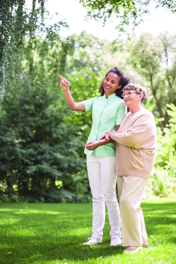 service franchise caregiver walking with a client