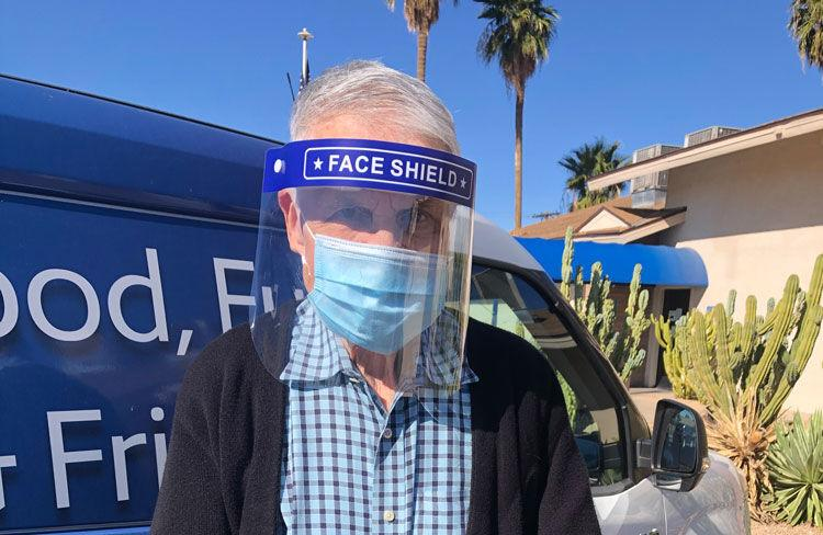 Senior Care A man wears a face mask and shield for COVID-19 protection